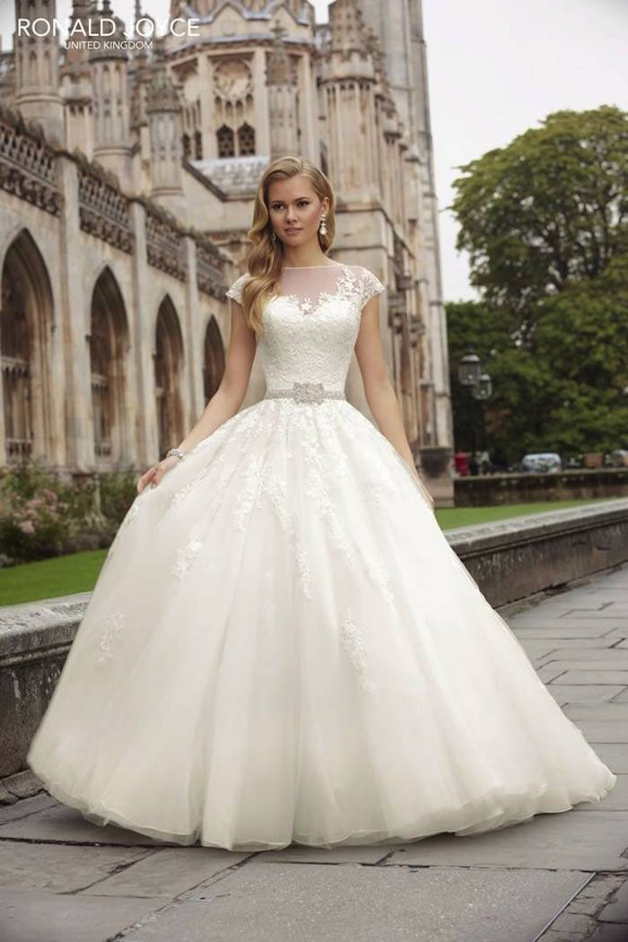 Modest wedding dresses with pretty details modwedding for Modest a line wedding dresses