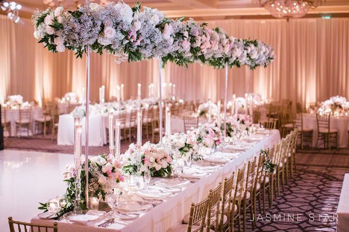 Create a wedding reception that is just as elegant as your ceremony by adding luxurious wedding floral centerpieces to your tables or decor.