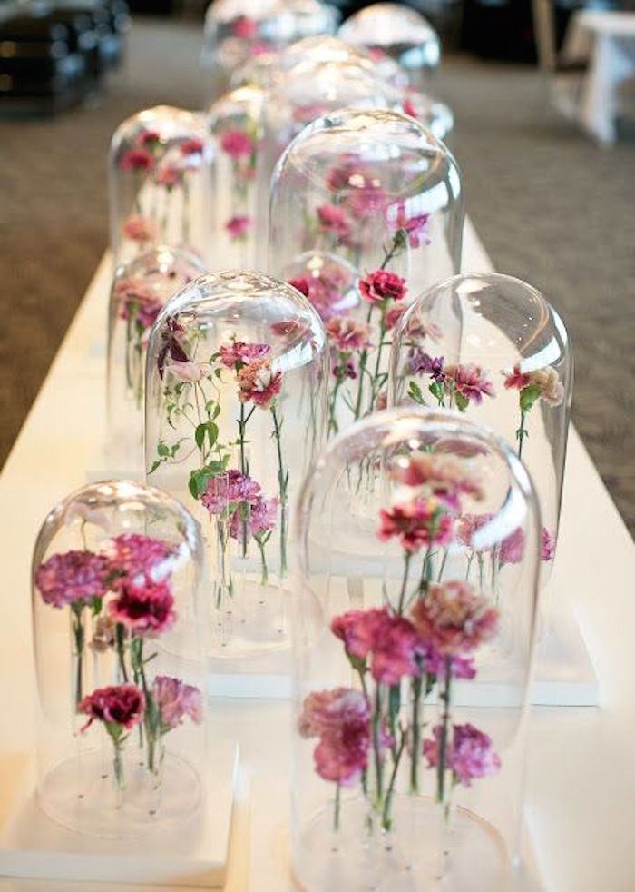 Unique wedding flower arrangements under glass domes